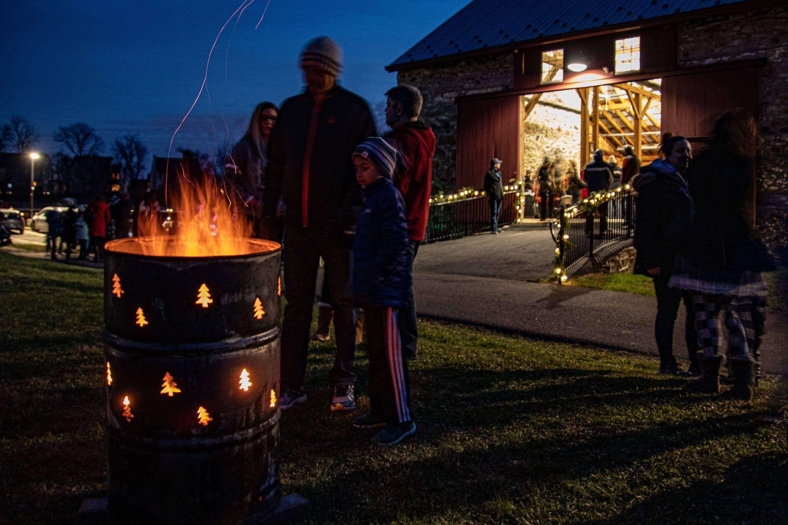 Upper Uwchlan Township Tree Lighting 2019 - photograph of people at festive fire barrel
