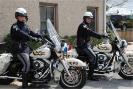 Two officers on police motorcycles