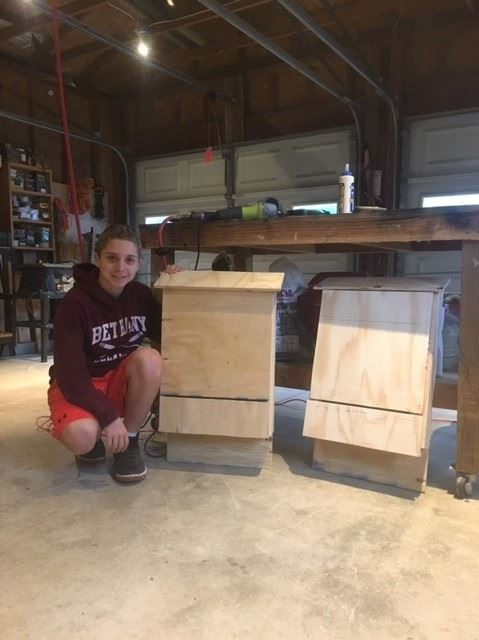 Evan with his bat completed bat boxes