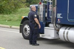 Officer conducting a motor carrier inspection